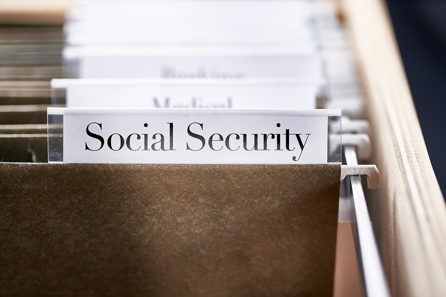 Social Security: Files and folders in desk drawer with labels and tabs: Home office management